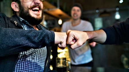 Happy Customer Fist Bumping Manager
