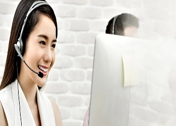 Customer Support Agent Smiling on a Call
