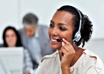 Woman Smiling During Customer Service Call